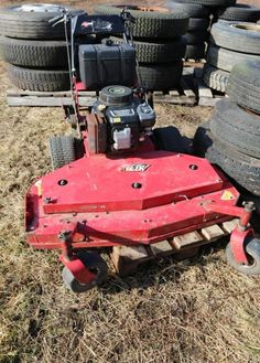 """Kawasaki FC420V walk behind lawn mower with 5 forward gears and reverse. Approx. 48"""" wide deck."""