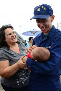 USCG Fireman Jarrid Romero meets his infant son Liam.