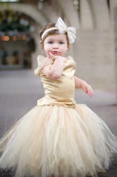 She is too cute! Look at that pose. You can't ask a little girl to do that. They do it all by themselves.