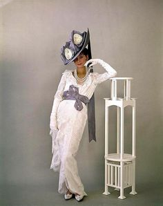 "Audrey Hepburn models the costumes of ""My Fair Lady"" for both photographer  costume designer for the film Cecil Beaton."