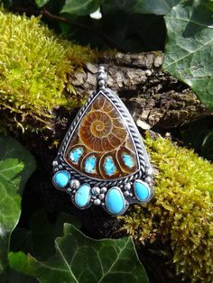 Healer by Rakupferamik on Etsy  ||  Materials: 925 silver, 999 FS, Ammonite, Turquoise, Sleeping Beauty Turquoise
