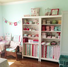 (tasha noel's sewing studio) - I love the shelving for fabric and supplies. It's moveable so I can rearrange my space as my needs change.