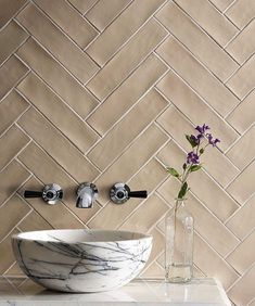 A softer update of the angular Metro tile, the slightly uneven edges of 'Gelato Peach' tiles - plus this beautiful… Sink Accessories, Decorative Accessories, Peach Bathroom, Mandarin Stone, Fragrant Candles, Floral Shower Curtains, Herringbone Tile, Fireplace Wall, Wet Rooms