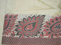 Red and Black Woven Paisley Border Chanderi blended cotton silk fabric. The width of the border is about 5 inches throughout the length, horizontally.You can use this fabric to make dresses, tops,...