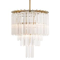 <b>Material: Fluted Glass/Plated Steel Finish: Clear/Antique Brass Number of Lamps: 7 Socket Type: Type B - E12 Bulb Type: B10 Incandescent</b>  The staggered antique brass rods at the top of the chandelier form a jewelry-like collar that the first tier of fluted triangular glass rods are suspended from. Three more tiers hide the seven lights and create a beautiful diffused light.