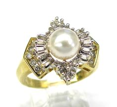 Ladies 14kt yellow gold diamond estate ring. Ring contains a 7mm pearl. 22 brilliant round cut diamonds and 10 tapered baguette diamonds weighing a total of approximately .50ct.