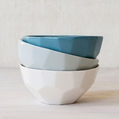 A small faceted ceramic dipping bowl made from high quality porcelain clay. The bowls are handmade in Auckland, and are currently available in a white gloss and soft green glaze. Dishwasher safe.
