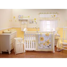 Yellow nursery - but I'd swap the flowers for cute animals so it's unisex