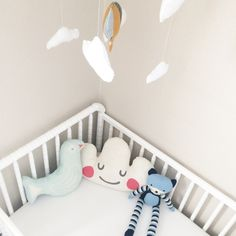 Modern, Whimsical Nursery with Cloud Pillow and Hot Air Balloon Mobile - Project Nursery