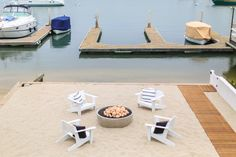 Firepit and white chairs with blue and white pillows. Winkle Custom Homes. Melissa Morgan Design. Ryan Garvin Photography