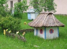 A Ukrainian 'house hive' - - the only thing I'd do differently here is put it up on something to help keep the ants away!