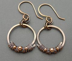 These earrings are made from hand formed and hammered copper circles. Wrapped onto the circles are little solid copper beads in 2mm and 3mm size. The