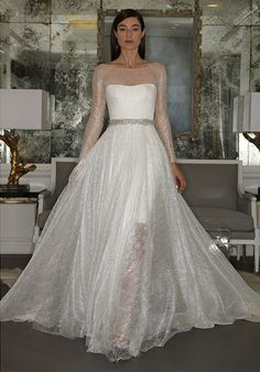 Romona Keveza Collection RK5445 Ball Gown Wedding Dress  Illusion gown made of stardust lace.  Transparent ball gown layered over narrow underskirt.  I love the stardust lace.  I have not seen it on another wedding dress ever.  D.Martin