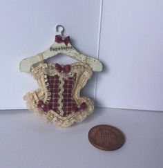 Handmade 1:12th Scale DollHouse Miniature Corset -Ladies Victorian style Burgundy bows Cream Lace Corset on pepeterie advert Hanger by Miniaturefrills on Etsy