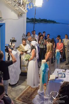 Wedding ceremony by the sea , decoration in white and blue shades. The bride in a relaxed mood with ancient wedding. For more inspiration visit: www.diamondevents.gr    You can also find us on:  https://instagram.com/diamond_event_planners/  https://www.facebook.com/pages/Diamond-Event-Planners/176242063682 https://www.pinterest.com/diamondwedding/