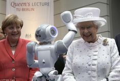 Nice work: Earlier today the Queen was joined by Mrs Merkel for a visit to the Technische Universitaet in Berlin where she saw a waving robot