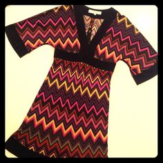 TRINA TURK dress under $100?! Great Summer find!!! OMG right?! ABSOLUTELY AMAZING Trina Turk silk dress in a fabulous chevron print! Great colors! Empire banded waist. Flowy sleeves. Great stretch, zipper back. I don't know the original price, but if you are a fan of Trina Turk you know what a great deal this is! So pretty & just in time for summer; would wear well with flat sandals or dress it up with heels! Trina Turk Dresses