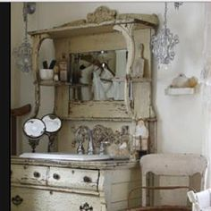 Antique buffet repurposed into a bathroom sink.