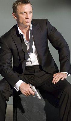 tux from Casino Royale. Flat black tux - no vest or cumberbun. black bowtie.