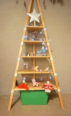 Want a Christmas Tree that's not a Christmas Tree? The IKEA PS 2014 Wall Shelf is just the perfect shape for a quick and easy tree. IKEA items used: PS 2014 Wall Shelf (beech) Clear all the items o Diy Paper Christmas Tree, Funny Christmas Tree, Ikea Christmas, Simple Christmas, Christmas Humor, Christmas Decorations, Christmas Ideas, Holiday Fun, Xmas