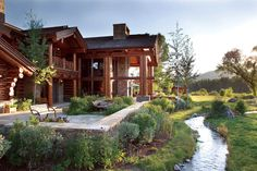 Wyoming back porch with a creek. This log home is so lovely.  www.precisioncraft.com