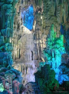 The Reed Flute Cave (China)  Outside the city of Guilin, the Reed Flute Cave is a popular travel destination while in China. The cave get's it's name from the reeds growing inside that are ideal for flute making. Reed Flute has a gambit of miraculous rock and mineral formations, carbon deposits, and stone pillars. The tourist attraction is illuminated by different colored lights giving it an other worldly feel.