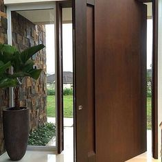 Project developed by architect Lilian Bianccini - Cortén Naturacor® Pivoting Steel Door and Wall Covering: - - Wooden Front Doors, Front Door Entrance, House Entrance, Entry Doors, Modern Entrance Door, Apartment Entrance, Modern Front Door, Front Entry, Wood Doors