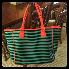 NWT deux lux Raleigh Tote bag Beautiful deux lux tote bag, tangerine trim, green and black stripe design, comes with a mint green linen bag with deux lux logo, **three stitches on the top left corner have come loose. These can be easily fixed** Purchased at Barney's New York. Deux Lux Bags Totes