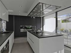 Boffi kitchen. like this combo: white cabinets/dark wood/ countertops