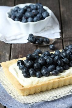 Blueberry Mascarpone Tart - Fresh blueberries and mascarpone filling sits on top of a lemon cookie crust! The perfect summer dessert!