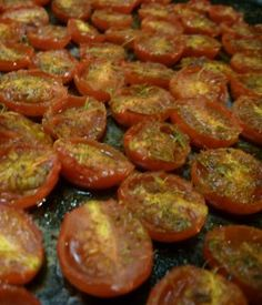 Homemade Pizza Sauce - Made from tomatoes from the garden.  The recipe calls for grape tomatoes, but I used what I had on hand.  Super easy!!!  I did have to add a small can of tomato paste to help thicken it up.  I also added more spices, and a tiny bit (1 T) of sugar.  I froze it in small containers instead of canning it.  Great way to use those tomatoes!!!