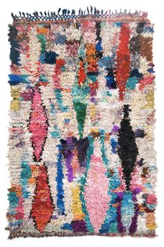 """The free-form composition of these rugs, all woven by women are, as Cavin-Morris Gallery says """"a liberation from tradition, while at the same time that they uphold it.  But there are no rules, and there is no way to look at a rug, and pinpoint exactly where it comes from.  They are Pan-Moroccan."""""""