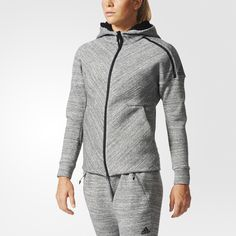 The adidas Z.N.E. collection was designed to provide premium comfort to athletes as they go from the street to the game. Kick back on the long drive to an away match in this women's jacket. Built with athlete-friendly details, the full-zip jacket has an extra-roomy hood you can pull over your eyes if you need some rest. It's made of textured heathered knit fabric cut for an athletic, tapered fit. Inner sleeve pockets keep your small essentials close.