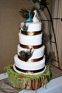 peacock wedding cake: Very simple love the two different peacocks on top. royal blue ribbon instead of brown and not on moss