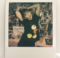Winona Ryder wearing a Damien Hirst Mickey Mouse Tee, in Robert Rich's office. Pic posted on RR's Instagram. Bottom right corner is an issue of Details Mag with Johnny on the cover