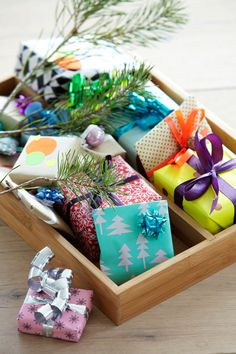 i would buy small plain white jewelry boxes and fill with everyone's favorite holiday candies before wrapping and placing in a big bowl.