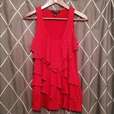 WHBM Red Ruffle Tank with Silver A red ruffled tank with silver details. From White House Black Market, in EUC, worn maybe twice. Can stretch to fit a small/medium. No flaws. White House Black Market Tops Tank Tops