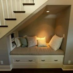 Reading nook under a staircase.