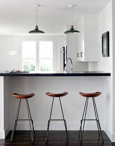 simple black white cognac kitchen palette. great stools