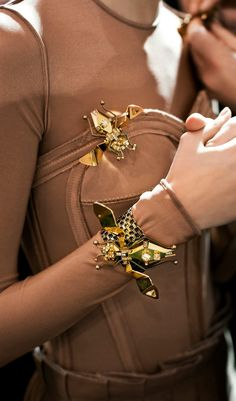 Can't imagine an insect on your arm? Maybe you should. From the runway to the streets,