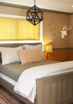 Modern Lighting in Orange and Brown Hunting Themed Room