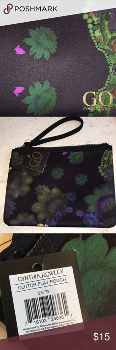 NWT CYNTHIA ROWLEY GO CLUTCH! EXQUISITELY DESIGNED BY CYNTHIA ROWLEY!! Black background with botanical print accented with magenta rabbits& bright yellow dragon fly! NEOPRENE WITH HEAVY GAGE NYLON ZIPPER ACROSS TOP /SOLID BLACK NEOPRENE WRISTLET STRAP! Received as gift- excellent condition ! Cynthia Rowley Bags Clutches & Wristlets