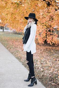 Gray sweater + black scarf + black distressed skinny jeans + booties + hat
