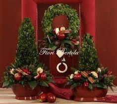 Risultati immagini per composizioni floreali natalizie