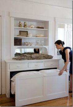 Trundle bed tucks away under counters in the kitchen and walk-in closet.