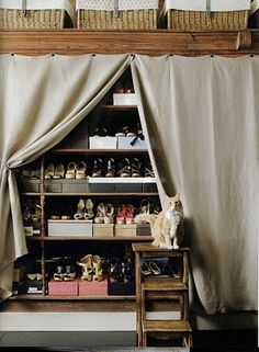 Love this closet very creative...Hanging linen as draperies to open as one pleases! Very clever use of space.
