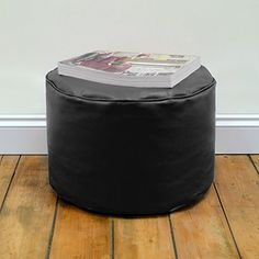 Round Beanbag Stool in BLACK Faux Leather by Bean Bag Bazaar This well-proportioned footstool gives you a comfortable place to rest your feet after a long day's work! Made from stunningly soft faux leather you won't want to put your feet anywhere else after using this bean bag footstool! At the perfect height for using whilst sat on a sofa or one of our matcing bean bags your feet will be propped up gently while you sit back, turn on the TV and enjoy a quiet nigh