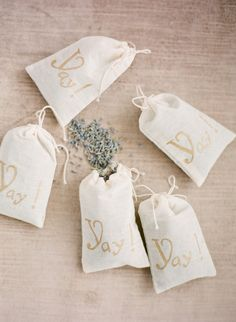 """""""Yay!"""" pouches to to hold lavender for lavender toss. Photography by ktmerry.com, Styling by styleserendipity.com, Floral Design by bestofbudsflorists.com"""