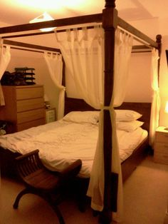 superking-sized 4 poster bed. Made to order in Brunei. I LOVE this bed!
