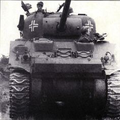 An American M4A3(76W) Sherman tank captured by the Germans & put to use in France.